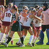 JIM VAIKNORAS/Staff photo Newburyport's #8 Meagan Brogole is congratulated by teammates after scoring a second half goal against Pentucket Friday afternoon at Newburyport. The Clippers won the game 2-0.