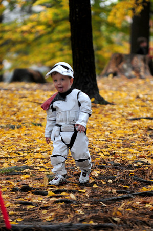 JIM VAIKNORAS/Staff photo Ewen Sullivan, 2, walks trough the woods Under the Pines dressed as a Storm Trooper for Fall Festival at Amesbury Park, Ewen went on to win the costume contest ,along with the contest  kids and grownup also enjoyed a parade, crafts, games, music and a pie eating contest.