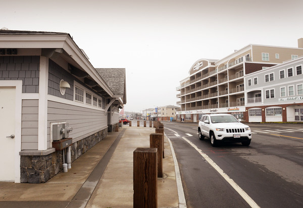 BRYAN EATON/Staff photo. One of several new bathhouses the state of New Hampshire built in 2011 is at left, and a new buildings with businesses on the first floor and condos above have been built where a fire destroyed the Surf Hotel in 2010.