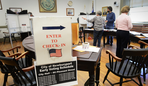 BRYAN EATON/Staff photo. Early voting started yesterday in city council chambers at Newburyport City Hall with a good number of people casting their ballots. Voting early will continue this week and into next week.