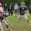 JIM VAIKNORAS/STAFF photo Pentucket's Liam Sheehy turns the corner on a run against Masco at Pentucket Saturday.