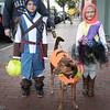 BRYAN EATON/Staff photo. Jacob Downs, 8, with sister Hailey, 6, their dog Reese's and mom Jen walk to downtown Amesbury last night. They were going to businesses for sweet treats in the Amesbury Chamber of Commerce and Industry's annual Downtown Trick or Treat.