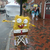 JIM VAIKNORAS/Staff photo A Sponge Bob scarecrow complete with Crabby Patty, stands in the rain Sunday in Market Square. The scare crow was part of the annual Harvest Festival Scarecrow contest. The festival continues Monday hopefully with better weather.