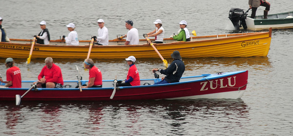 JIM VAIKNORAS/Staff photo The Zulu and the Gannet que up during the Fall Haul and Mighty Merrimack Rowing race at Lowell Boat Shop in Amesbury.About a dozen boats competed in the race, later rowers and spectaters enjoyed burgers, a chili contest, and the music of The Demijon Music Clan.
