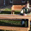 JIM VAIKNORAS/Staff photo Timothy Friend, 14, sits ot  the GAR Memorial Library on one of  two benches that convert into picnic tables. A member of the Merrimac/West Newbury Boy Scout Troop 41, Friend made the benches out of white cedar wood and weather proofed them as part of his work towards achieving the rank of Eagle Scout. He also raised $520 through a bake sale, which he donated to the library to enhance the book collection in its teen room. Friend, who lives on Main Street, has been visiting the library weekly with his family since he was a toddler and wanted to do something special for it as a thank you. The Pentucket freshman has three remaining merit badges to complete before becoming an Eagle Scout. His Court of Honor will likely be scheduled in 2018.