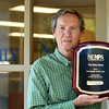 BRYAN EATON/Staff photo. Newburyport News managing editor Richard K. Lodge accepted the newspaper's award for Newspaper of the Year by the New England Newspaper and Press Association.