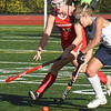 BRYAN EATON/Staff photo. Jamie Bell moves the ball with Masco's Amyouny in the chase.