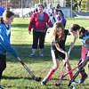 BRYAN EATON/Staff photo. Amesbury Middle School girls practice field hockey on Tuesday's at the Amesbury Town Park. Several former high school players, including Kristen Dore, pictured, help to coach.