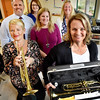 BRYAN EATON/Staff photo. The family of the late Dick Kaplan, a well-known local musician, donated $2,770 to Triton Regional District Schools from a foundation created for his memory. Presenting the instruments to school officials are his daughters, Laura Kaplan Valme, left, and Abigail Kaplan Broughton. Back from left, school superintendent Brian L. Forget; business administrator Michelle Cresta; Newbury Elementary School principal Beth Yango and district elementary band teacher Deb MacKinnon.