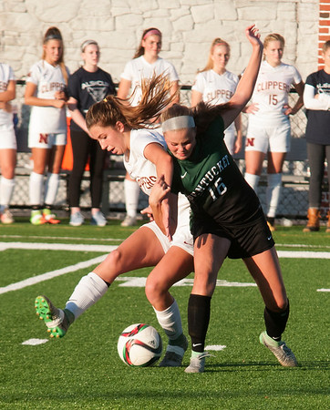 JIM VAIKNORAS/Staff photo  Pentucket's Jacey Jennings fights for the ball with Newburyport's Margaret Cote during the ALS cup in Newburyport Saturday night.