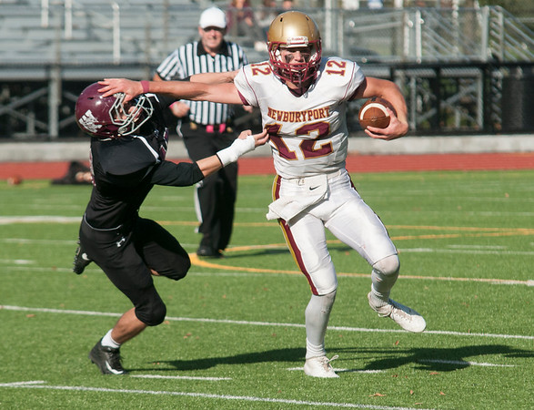 JIM VAIKNORAS/Staff photo Newburyport's Owen Bradbury stiff arms a Weston player Saturday at Wellesley High School.