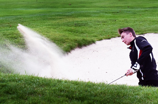 BRYAN EATON/Staff photo. Amesbury's Ryan Patterson gets out of the sand trap.