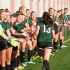 JIM VAIKNORAS/Staff photo The Pentucket girls soccer team cheers as their starters are introduced at the start of the annual ALS cup game against Newburyport Saturday night at World War Memorial Stadium in Newburyport. Newburyport defeated the Sachem 2-0 in the game. In the 2nd game the Newburyport boys defeated Pentucket 3-1.