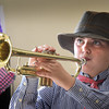 "BRYAN EATON/Staff photo. Piper Allard, 11, holds still until someone pushes a fake button bringing to life the trumpet play of Louis Armstrong who she's portraying at the River Valley Charter School. The students did a bit of a twist when it comes to Halloween, reading biographies based on someone ""Dead and Famous"" the bringing the people to life in a pseudo wax museum environment."