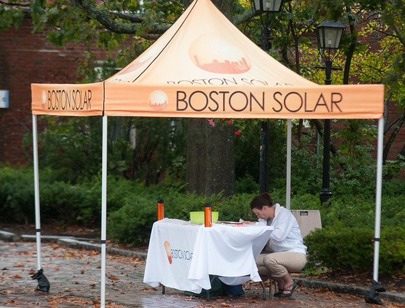 JIM VAIKNORAS/Staff photo Monday's rain kept most of the vendors from setting up for the annual Harvest Festival in downtown Newburyport, ironically one of the few who did was Anita Cala of Boston Solar.