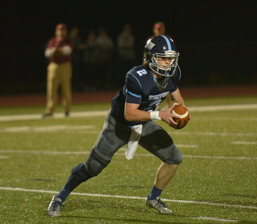 JIM VAIKNORAS/Staff photo Triton's Thomas Lapham looks for running room against Newburyport at Triton Friday night.
