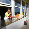 BRYAN EATON/Staff photo. Christy's and Tripoli's Pizza shops at Salisbury Beach are always open it seem, even during bad storms. Only Tripoli's was on Monday as Laurindo Pinheiro had a small generator for his cash register and radio. The ovens are, of course, gas-powered but he was only to sell pizza until 2:30 when he ran out of dough he made yesterday. The generator isn't strong enough to power the huge mixer.