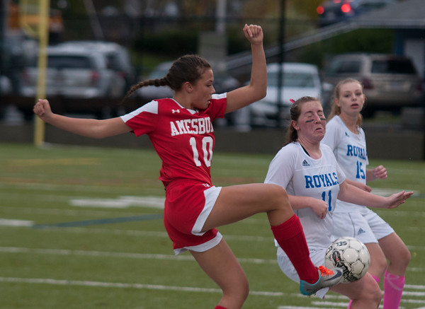 JIM VAIKNORAS/Staff photo Georgetown's Caitlin Donoghue blocks a kick by Amesbury's Maddie Morris during their game at Georgetown Thursday.