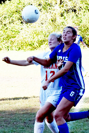 BRYAN EATON/Staff photo. Amesbury's Chelsea Lynch and Casey Smith collide trying to head the ball.