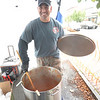 JIM VAIKNORAS/Staff photo Salisbury police Sgt.Steven Sforza stirs a big pot of chili at the Annual Amesbury Firefighters Chili Cook-off Saturday at the Friend Street parking lot. Teams from the surrounding communities competed in the event.