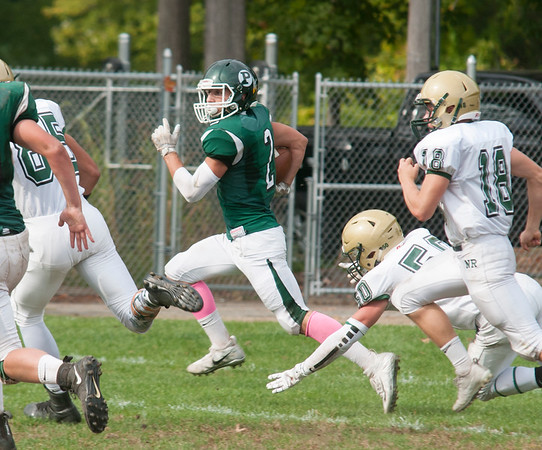 JIM VAIKNORAS/Staff photo Pentucket's Nathan McGrail returns a kick against North Reading during their game at Pentucket Saturday.