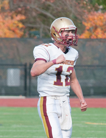 JIM VAIKNORAS/Staff photo Newburyport quarterback Owen Bradbury pumps his fist after a touchdown against Weston at Wellesley High School Saturday.