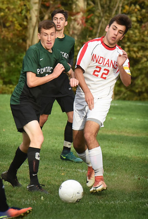 BRYAN EATON/Staff photo. Pentucket's Patrick Sullivan and Pat Ivers converge going for the ball.