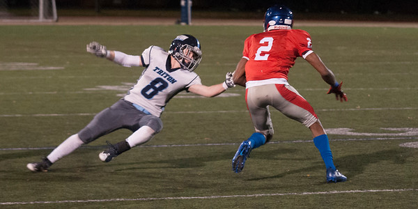 JIM VAIKNORAS/Staff photo Triton's JDylan Leavitt dives to make a play on Somerville's Jiovanny Pierre during their game at Dilboy Stadium in Somerville Friday night.