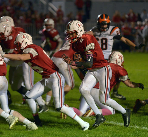 JIM VAIKNORAS/Staff photo Amesbury's Zachary Levarity scores against Ipswich Friday night at Landry Stadium in Amesbury.