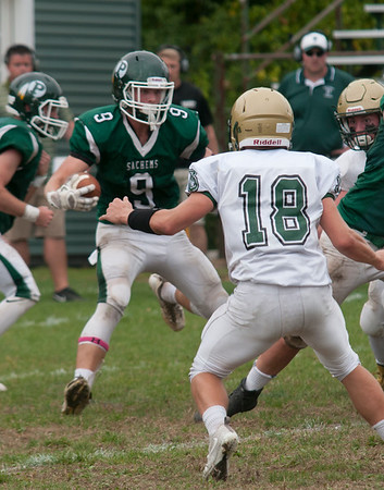 JIM VAIKNORAS/Staff photo Pentucket's Ethan Dore takes a handoff against North Reading during their game at Pentucket Saturday.