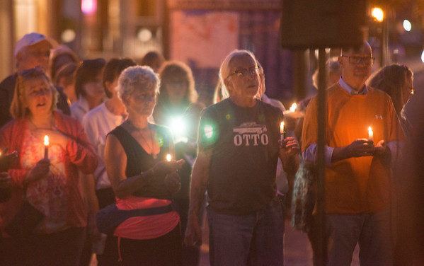 JIM VAIKNORAS/Staff photo People light candles as the names of the victims of Sunday's shooting in Las Vegas are read at a vigil in Market Square in Newburyport.