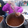 JIM VAIKNORAS/Staff photo Allie Simons, 8, serves chili at the Annual Amesbury Firefighters Chili Cook-off Saturday at the Friend Street parking lot. Allie is the daughter of Newburyport Police Lt. Matthew Simons.