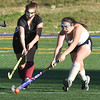 BRYAN EATON/Staff photo. Amesbury's Madison Robicheau moves the ball past Sarah Murphy.