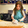 BRYAN EATON/Staff photo. Leah Tarkan, 6, creates designs on her desk using shaving cream to draw in at the Bresnahan School in Newburyport on Tuesday. Teacher Mary Ahern had her students work on their numbers and spelling in a fun way to continue to learn the basics.