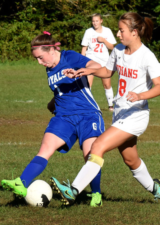 BRYAN EATON/Staff photo. Georgetown's Rylie Lasquade and Ashley Pettet try for control.