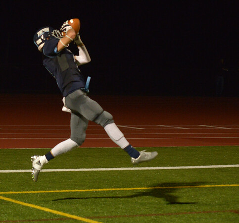 JIM VAIKNORAS/Staff photo Triton's Christian O'Brien and his shadow catch  touchdown against Newburyport at Triton Friday night.