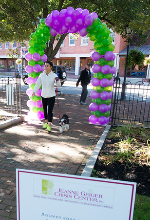 JIM VAIKNORAS/Staff photo Stacey Dellecroce of Georgetown along with her dog Sam complete the Walkathon for Jeanne Geiger Center Sunday morning at Market Landing Park in Newburyport.