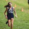 BRYAN EATON/Staff photo. Triton's Ellie Gay-Killeen crosses the finish.