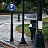 JIM VAIKNORAS/Staff photo A woman walks up Merrimac Street near Green Street in the morning rain Monday.