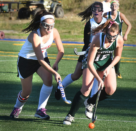 BRYAN EATON/Staff photo. Amesbury's Nora Cronin and Pentucket's Jacqui Cloutier chase the ball.