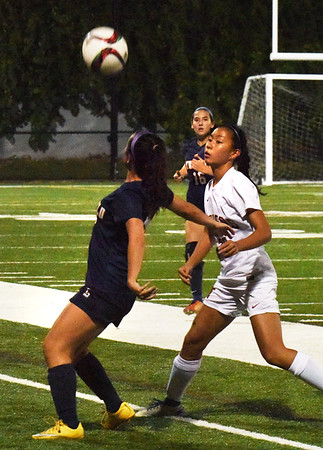 BRYAN EATON/Staff photo. Lucy Eramo moves in as a Lynnfield player heads the ball.
