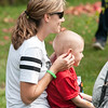 JIM VAIKNORAS/Staff photo Tommy Cook, 4, has his ears blocked by his mom Katie as a convoy of more than 70 trucks make their way past his house on Meadowview Road in Georgetown Saturday afternoon. Tommy's family and friends throw him a party to celebrate his liver cancer going into remission. Along with the trucks, there was food, games, presents, and a visit from Bruin's mascot Blades.