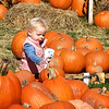 BRYAN EATON/Staff photo. Mary Claire Hines, 2, of West Newbury checks out the pumpkins at the Main Street Congregational Church is Amesbury which are for sale as a fundraiser. She and her grandmother, Susan Hines of Newburyport, had been in the Children's Room at the Amesbury Public Library next door.