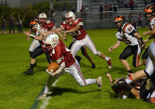 JIM VAIKNORAS/Staff photo Amesbury's Patrick Birmingham steps out of a tackle against Ipswich Friday night at Landry Stadium in Amesbury.