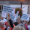 JIM VAIKNORAS/Staff photo People hold Moms Demand Action signs at a vigil in Market Square in Newburyport for Sunday's shooting in Las Vegas.