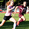 BRYAN EATON/Staff photo. Pentucket's Anna Wyner and Rockport's Liz Higgins move after the ball.