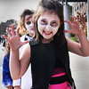 """BRYAN EATON/Staff photo. Alexa Warchos, 8, gives a scare as she plays a """"motorcyble zombie Tuesday afternoon in Newburyport's Bresnahan School Halloween Parade."""