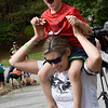 JIM VAIKNORAS/Staff photo Tommy Cook, 4, sits on his mom Katie's shoulders as a convoy of more than 70 trucks make their way past his house on Meadowview Road in Georgetown Saturday afternoon. Tommy's family and friends throw him a party to celebrate his liver cancer going into remission. Along with the trucks, there was food, games, presents, and a visit from Bruin's mascot Blades.