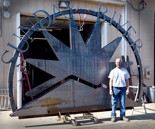 BRYAN EATON/Staff photo. Dan Wilson of Wilson Welding in Salisbury recently made a sign for Sunday River ski resort in Maine.