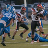 JIM VAIKNORAS/Staff photo Ipswich's Justin Moran breaks a tackle at Georgetown Friday night.